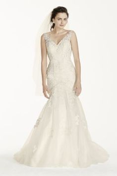 Fit and flare, this tulle mermaid gown is sure to impress! Designed with tank straps, low scoop back and allover beading, you\'ll be a chic bride on your wedding day in this elegant design.  Jewel, ex