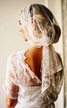 Bride's Grace Kelly retro finger curl chignon bridal hair ideas  Toni Kami Wedding Hairstyles ♥ ❶  Gathered under bun gorgeous Swiss dot veil