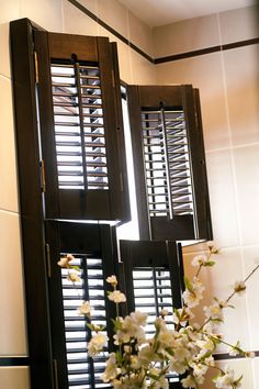 Swag curtain valance over wood blinds swag curtains for Should plantation shutters match trim