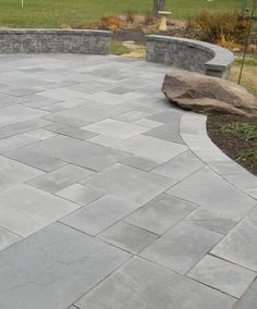 Light grey coloured stone pavers for rear garden patio and step