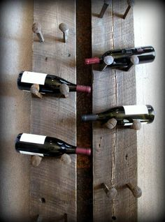 Upcycled Railroad Spike Wine Rack DIY. It's not only practical but a piece of art for your home, too. From @bjstrix.