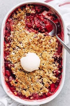 Strawberry Rhubarb Crisp is quick and easy to make desserts at only 263 calories per serve! Strawberries mix with rhubarb underneath an oatmeal cookie top.