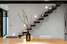 Contemporary Dark Brown Floating Staircase And White Wall Design Ideas: Compact Modern Leisure Home in Brazil, House 7×37 by CR2 Arquitetura