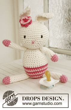 """Crochet DROPS Easter bunny with flower in """"Paris"""". ~ DROPS Design"""
