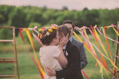 colorful ribbon ceremony backdrop | DIY Budget-friendly Barn Wedding | Love and Perry Photography