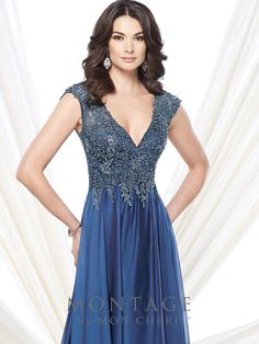 Cap sleeve two-tone chiffon and metallic lace A-line gown with deep V-neckline, metallic lace bodice, keyhole illusion back, gathered chiffon skirt with sweep train. Matching shawl included. Sizes: 4 – 20, 16W – 26W Colors: Royal Blue, Dark Aqua, Pink Sapphire