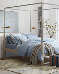 We love this sophisticated bedroom with a four poster bed, patterned rug, and brass floor lamps. Our woven cotton throw adds beautiful texture to the blue bedding. Blue Bedding Sets, Blue Duvet, Luxury Bedding Sets, White Bedding, Comforter Sets, Bed Sets, Crib Sets, Magazine Design, Living Room Furniture