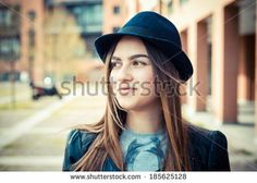beautiful brunette young woman in the city - stock photo BUY IT FROM $1 ON SHUTTERSTOCK