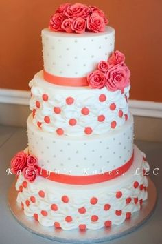 Coral wedding cake maybe with canna Lillie's instead of roses