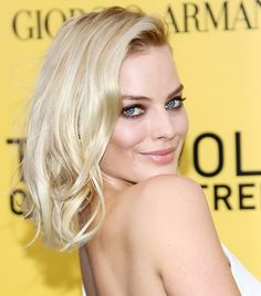 Margot Robbie's platinum blonde waves and kohl-rimmed eyes
