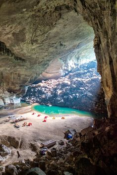 Camping adventure inside the world's third largest cave! Hike through the lush jungle in central Vietnam to reach this natural marvel, camp overnight and hike back out. This cave is so large it has it's own beach! Quang Binh Province, Vietnam.