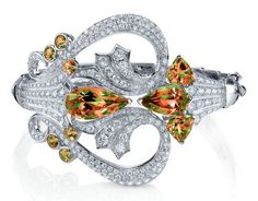 Stephen Webster. Couture cuff in 18ct White Gold Bracelet set with pave White Diamonds and pear shaped Zultanite stones