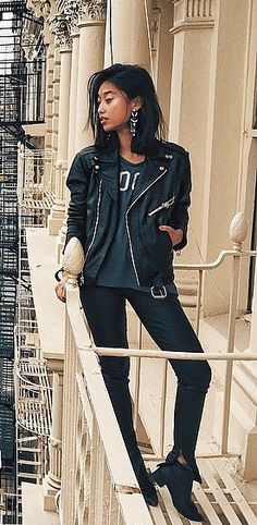 Wear a leather jacket with a slouchy t-shirt and jeans.