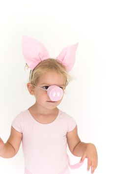 For our three little pigs costume, we made pig ears, noses, and tails that are no-sew and take only a few minutes to make. Here's how todo it… First up the tail: Supplies: Pink elastic, pink felt, pink pipe cleaner, fabri-tac or hot glue, scissors Step 1: Cut a piece of felt a bit longer …