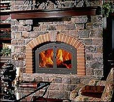 Factory-built fireplaces don't have to look metallic. The masonry surround for this metal fireplace gives a traditional look along with predictable performance, at a savings over a site-built masonry fireplace.