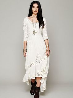Mexican Wedding Dress: Stunning high-low maxi dress with intricate floral embroidered detailing and crochet inset all over. Fitted at the waist. Cutout back. 3/4-length sleeves.  $198