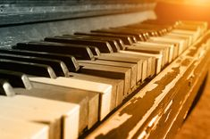 Buy Vintage Piano by on PhotoDune. Photo the old piano in the light of the evening sun, with the broken keys and the peeled off paint. Shallow Depth of .