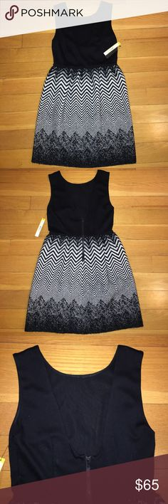 Alice + Olivia Dress NWT Alice and Olivia black dress. Material: top half is a rayon/nylon blend and the bottom part is a wool/polyester blend. Cute zigzag pattern. Back had a U-shape with exposed zipper. Alice + Olivia Dresses