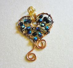 Copper, gold (brass) and black wirework pendant with AB black faceted oval beads. Made by me!