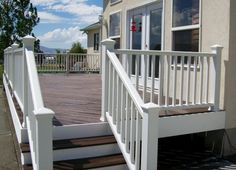 The paint is peeling off of our cedar railings. I want to replace with Trex railings. These are Trex Transcend railings in classic white.