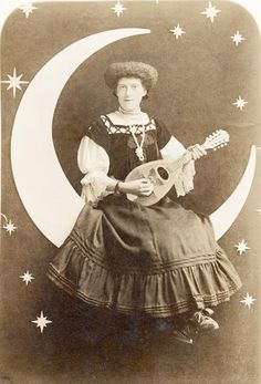 Woman with mandolin on paper moon