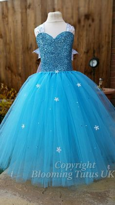 This beautiful handmade extremely sparkly Elsa inspired dress is made with over one hundred metres of material to make a dress fit for a queen.