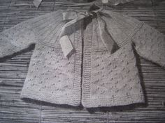 This cardigan uses less than 100 grams of fingering weight yarn. A good project for oddballs or leftovers.