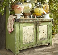 pb green outdoor console. I love the distressed look of this piece..I am going to have to try this.
