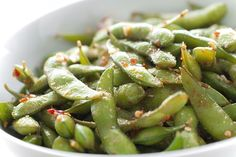 Best edamame recipe... with sesame instead of peanut oil. Oh my I am going to love this, but slightly less sambal, my mouth would die!