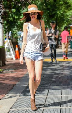 Cutoffs, tank, booties and a floppy hat with some sunnies and a bag