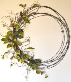 Barbwire wreath for Spring! See website for more unique items.