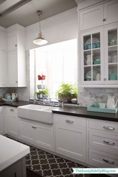 White Cabinets, Black Counter, Marble Backsplash, And An Incredible Garden  Window Using Black