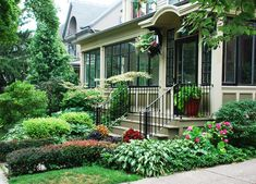 Period home with closed in front porch, front stoop with steps, landscaping for small front yard