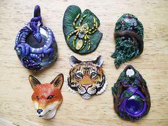 Pendants in progress by Hidden-Treasury.deviantart.com on @deviantART  Love the dragon and the purple piece on the bottom right.