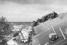 USS Cowpens rolling in heavy seas in Typhoon Cobra in the Pacific Ocean 18 December 1944.