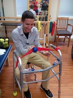 A developmental goal of slingshot therapy is for patients to have the ability to pull back the ball and catapult it. A psychosocial goal is for patients to put two and two together that when they pull the ball back, it will sling out. Geriatric Occupational Therapy, Occupational Therapy Assistant, Occupational Therapy Activities, Pediatric Physical Therapy, Nursing Home Activities, Elderly Activities, Dementia Activities, Ot Activities For Geriatrics, Games For Elderly