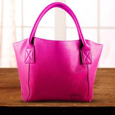 A Bag-About-Town - From days at the office to shopping excursions, these beautiful bags offer a posh yet professional appearance. Boasting sleek shoulder bags, dome satchels, cotton-lined totes and more, these bags provide fashion and function. Whatever's on the schedule, you'll get it done in style.