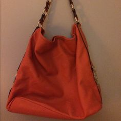 Orange bucket purse Cute Dana Buchman orange purse with gold accents and zebra striped lining. Gently used . Inside is in good condition. Alittle worn in stitching - see pics. Great pop of color! Dana Buchman Bags Shoulder Bags