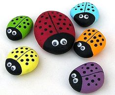 We made these as potted-plant sitters for Grammie! ladybug rocks: acrylic paint, eyes, black marker & acrylic sealer spray. I fancy a family of them out the garden.