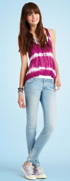 Super skinny jeans with purple tank