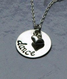 Dance - Sterling silver necklace with hand stamped pendants and sterling silver heart charm. $26.00, via Etsy.