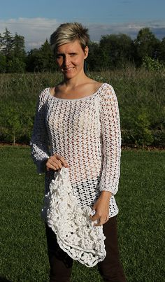 FREE CROCHET PATTERN @ Ravelry: crochet tunic thousand flowers pattern by Petra Kotrysova - This lacy top is gorgeous but the pattern leaves something to be desired in it's translation to English. The collar piece is not included apparently. Advanced crocheters for this one.