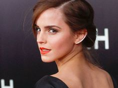 Worn best with a slick and a lip.  Emma Watson pairs her jewels with a backless gown at the Noah Premiere.