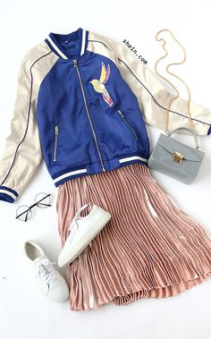 Embroidered bomber jacket with blush skirt.