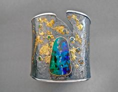 GOPH STUDIOS opal ring - This hand-fabricated collection sets colored gemstones and diamonds in a dance among sterling silver and 18k gold. Crafted by forcing an ingot through a rolling mill until natural cracking occurs, each fissure becomes a focal point--complimented by hand-hammered texture and 18k gold overlays.