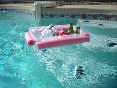$1.99 pool cooler float. Just a pool noodle, plastic bin, and string.