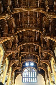 """The ornate ceiling of the Great Hall at Hampton Court Palace. There are carvings of little figures in the eaves of the ceiling, believed to be able to listen in on all the gossip happening below at court. This is where the term """"eavesdropper"""" was created. Dinastia Tudor, Tudor Style, Tudor History, British History, Medieval, Beautiful Architecture, Architecture Details, Royal Residence, Hampton Court"""