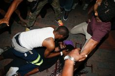 One person critically wounded and at least four officers injured as gunfire erupts during second night of protests over Keith Scott's shooting death in Charlotte