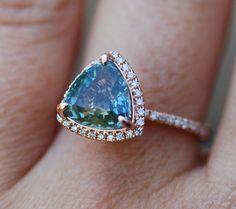 Rose Gold Engagement Ring Teal Blue Green Sapphire pear cut halo engagement ring 14k rose gold. by EidelPrecious on Etsy https://www.etsy.com/listing/241605259/rose-gold-engagement-ring-teal-blue