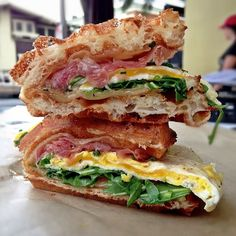 Wafffle breakfast sandwich: Prosciutto & Gruyere with fried egg and arugula